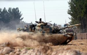 """Turkish tanks head towards the Syrian border, in Karkamis, Turkey, Wednesday Aug. 31, 2016. Turkey on Wednesday dismissed reports of a cease-fire deal with Kurdish rebels in northern Syria, and vowed to continue its week-old military incursion into the neighboring country until all """"terror entities are eliminated."""" Prime Minister Binali Yildirim said Wednesday that military """"operations will continue until all terrorist elements have been neutralized, until all threats to our borders, our lands and our citizens are completely over. """" (Ismail Coskun, IHA via AP)"""