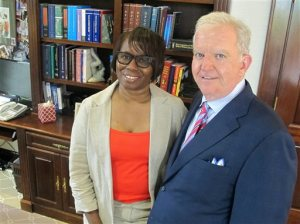 Felicia Sanders, a survivor of the shootings at Charleston's Emanuel AME Church, poses with attorney Andy Savage in Savage's office in Charleston, S.C., on Aug. 4, 2016. Savage represents Michael Slager, a white former policeman facing a murder charge in the shooting of a black motorist, as well as victims and the families of victims of the June, 2015 shootings at the church. Trials in both cases are scheduled to begin in Charleston this fall. (AP Photo/Bruce Smith)