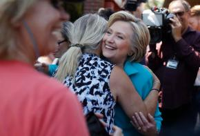 Clinton defends family foundation, says work willcontinue