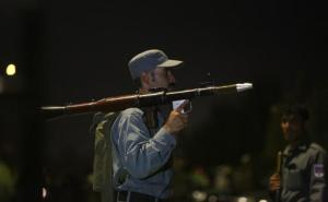 An Afghan policeman holds a rocket-propelled grenade launcher at the site of a complex Taliban attack on the campus of the American University in the Afghan capital Kabul on Wednesday, Aug. 24, 2016. University President Mark English told The Associated Press that security forces had arrived on the scene soon after the attack began around 7 p.m. (1430 GMT) (AP Photo/Rahmat Gul)