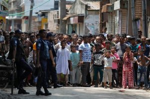 Bangladeshis gather near a shooting scene in Narayanganj, outskirts of Dhaka, Saturday, Aug. 27, 2016. Police in Bangladesh say they have killed three suspected militants, including Tamim Chowdhury, a Bangladeshi-born Canadian, who police believe was one of two masterminds of the attack on a popular restaurant in Dhaka. (AP Photo)