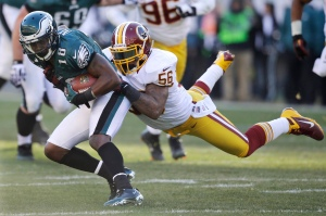 FILE - In this Sunday, Dec. 23, 2012 file photo, Philadelphia Eagles' Jeremy Maclin, left, is tackled by Washington Redskins' Perry Riley in the first half of an NFL football game in Philadelphia. The Washington Redskins released four-year starting linebacker Perry Riley and defensive lineman Stephen Paea as they continued to cut down to their 53-man roster, Tuesday, Aug. 30, 2016. (AP Photo/Mel Evans, File)