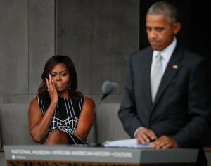 First lady Michelle Obama wipes aways tears as she listens to her husband President Barack Obama speak at the dedication ceremony for the Smithsonian Museum of African American History and Culture on the National Mall in Washington, Saturday, Sept. 24, 2016. (AP Photo/Pablo Martinez Monsivais)