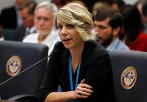 Dr. Andrea Hoopes of Children's Hospital gives testimony during a hearing of the Colorado state House Marijuana Cost-Benefit Analysis Intirim Committee, at the state Capitol, in Denver, Wednesday, Sept. 21, 2016. The panel of state lawmakers heard testimony on a range of issues Wednesday, including whether or not to give PTSD patients the ability to get a doctor's recommendation for marijuana, something many patient advocates have been seeking for more than a decade. While any vote would have no immediate legal effect, policy decisions by the interim legislative panels often carry significant weight when the full Legislature meets in January. (AP Photo/Brennan Linsley)