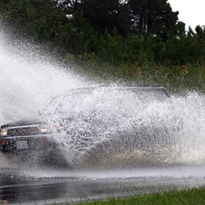 Stalled front and tropical storm deluge roads, closeschools