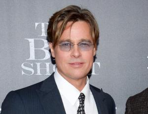 """FILE - In this Nov. 23, 2015 file photo, actors Brad Pitt attends the premiere of """"The Big Short"""" in New York.  Pitt is skipping his first public appearance after his split with Angelina Jolie. He says he won't attend the premiere of Terrence Malick's new documentary Wednesday night as scheduled. Pitt, who narrates """"Voyage of Time,"""" said in a statement Wednesday, Sept. 28, 2016, that he's grateful to have been part of the project, but is """"currently focused on my family situation and don't want to distract attention away from this extraordinary film.""""(Photo by Evan Agostini/Invision/AP, File)"""