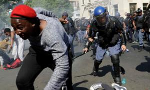 Students run for cover as police fire stun grenades and rubber bullets in an attempt to disperse them during their protest for free education in Johannesburg, South Africa, Wednesday, Sept. 21, 2016. A leading university in South Africa has closed for the rest of the week because of violence by protesters demanding free education across the country. (AP Photo/Themba Hadebe)