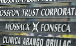 "FILE - In this Monday, April 4, 2016 file photo, a marquee of the Arango Orillac Building lists the Mossack Fonseca law firm, in Panama City. Denmark will buy leaked data from a Panamanian law firm that helped customers open offshore companies to avoid paying taxes, the Scandinavian country's taxation minister said Wednesday, Sept 7, 2016. Karsten Lauritzen said Denmark's tax authorities had received an anonymous offer over the summer to acquire data from the so-called ""Panama Papers"" that could involve up to 600 people. The ministry said communication with the anonymous source was made via encrypted channels. (AP Photo/Arnulfo Franco, File)"