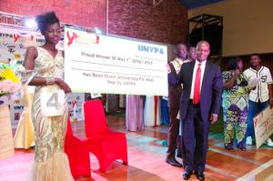 Tryphena Natukunda , left, a Ugandan living with HIV/ Aids the winner of the third annual Uganda Network of Young People Living with HIV beauty pageant at Golf Course Hotel Kampala, Uganda, Saturday Sept. 24, 2016. When she was younger, Tryphena Natukunda's mother discouraged her from swallowing her antiretroviral medicines among strangers or even distant relatives. Because she was suffering from AIDS, which can fuel stigmatization and invite harsh judgment, the mother wanted her child's condition kept a secret within the family. (AP Photo/Stephen Wandera)
