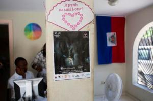 A Massimadi festival poster hangs at the Kouraj organization office in Port-au-Prince, Haiti, Tuesday Sept. 27, 2016.  The four-day Massimadi film, art and performance event was supposed to start Tuesday but organizers of the cultural festival celebrating Haiti's Afro-Caribbean LGBTQ community say it has been called off due to threats of violence. (AP Photo/Dieu Nalio Chery)