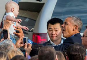 While greeting well wishers after arriving at John F. Kennedy International Airport in New York, President Barack Obama reaches out to Desmond Hatfield-Rudin, eight months old, of the Brooklyn borough of New York, Sunday, Sept. 18, 2016, in New York. (AP Photo/Craig Ruttle)