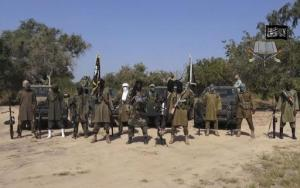 FILE - In this file image taken from video released Friday Oct. 31, 2014, by Boko Haram, Abubakar Shekau, centre, the leader of Nigeria's Islamic extremist group, surrounded by his fighters. Islamic extremists have killed eight soldiers and wounded 17 in two attacks in northeastern Nigeria, the country's military said Monday, Sept. 26, 2016. The attacks bring the official toll to 10 troops killed and 24 wounded this past week in a resurgence of violence after a lull as the extremists confronted a leadership struggle. (AP Photo/Boko Haram,File)