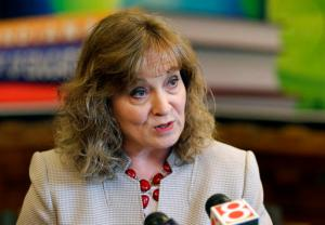 FILE - In this April 30, 2015, file photo, Indiana Superintendent of Public Instruction Glenda Ritz speaks at a news conference in Indianapolis. New details about a lucrative, no-bid contract are raising questions about how Ritz manages her state agency at a time she's running for re-election. The contract, engineered by a Ritz aide shortly before he left to work for the vendor, was not put out to bid or vetted by the state agency responsible for viewing big-dollar contracts, but instead was signed off by the Democrat Ritz's chief of staff as others raised red flags. (AP Photo/Michael Conroy, File)