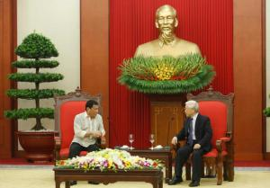 Philippine President Rodrigo Duterte, left, talks with Vietnam's Communist Party General Secretary Nguyen Phu Trong at the Party's headquarters in Hanoi, Vietnam, Thursday, Sept. 29, 2016. (Kham/Pool Photo via AP)