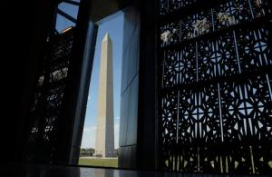 The Washington Monument is framed by a window at the National Museum of African American History and Culture in Washington, Wednesday, Sept. 14, 2016. (AP Photo/Susan Walsh)