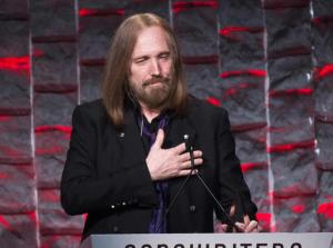 FILE - In this June 9, 2016 file photo, Tom Petty attends the 47th Annual Songwriters Hall of Fame Induction Ceremony and Awards Gala in New York. Petty will be honored as the MusiCares Person of the Year next year days before the Grammy Awards. The Recording Academy announced Wednesday, Sept. 28, that Petty will receive the prestigious honor in Los Angeles on Feb. 10, 2017. (Photo by Charles Sykes/Invision/AP, File)