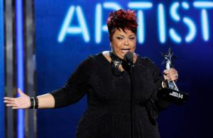 "FILE - In this June 29, 2014 file photo, Tamela Mann accepts the award for best gospel artist at the BET Awards at the Nokia Theatre on  in Los Angeles.   Mann found comfort in her new single ""God Provides"" after unexpectedly hearing it for the first time on the radio shortly after she was robbed outside an Atlanta restaurant a few months ago. The song is featured on singer and actress' fourth album, ""One Way,"" which also includes a guest appearance by hit-making producer Timbaland. The album is out Friday, Sept. 9, 2016. (Photo by Chris Pizzello/Invision/AP)"