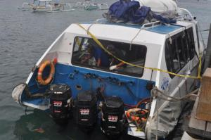 Police investigators examine the Gili Cat 2 boat following an explosion while it was enroute to nearby island of Lombok, at Padangbai Port in Karangasem, Bali, Indonesia, Thursday, Sept. 15, 2016.  Police on the Indonesian tourist island of Bali said Thursday a German woman was killed and about 20 other people injured in an explosion on a speed boat ferrying them to neighboring Lombok. (AP Photo)