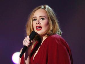 "FILE - In this Feb. 24, 2016 file photo shows Adele onstage at the Brit Awards 2016 at the 02 Arena in London. Adele told the crowd at her show in New York City on Sept. 20, 2016, that news of Brad Pitt and Angelina Jolie's divorce ""feels like the end of an era."" (Photo by Joel Ryan/Invision/AP, File)"