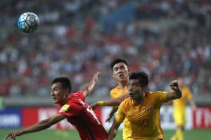 South Korea's Ji Dong-won, left, fights for the ball against China's Zheng Zhi, right, during the soccer match for the 2018 FIFA World Cup qualifier at Seoul World Cup Stadium in Seoul, South Korea, Thursday, Sept. 1, 2016. (AP Photo/Lee Jin-man)