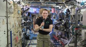 In this image from video made available by NASA, U.S. astronaut Kate Rubins speaks aboard the International Space Station during an interview on Thursday, Sept. 22, 2016. Rubins said that she doesn't know yet whether she'll return to Earth in late October as planned. The Russians have delayed the next crew launch for technical reasons. (NASA via AP)