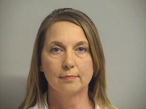 This photo provided by Tulsa County Inmate Information Center shows Tulsa police officer Betty Shelby. Tulsa County jail records show that Shelby turned herself in early Friday, Sept. 23, 2016, hours after prosecutors charged her with first-degree manslaughter in the death of Terence Crutcher. (Tulsa County Inmate Information Center via AP)