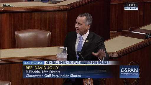 In this frame grab from video provided by C-SPAN Rep. David Jolly R-Fla. holds a container of mosquitoes while speaking of the House floor on Capitol Hill in Washington Wednesday Sept. 7 2016.