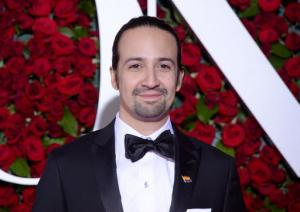 "FILE - In this June 12, 2016 file photo , Lin-Manuel Miranda arrives at the Tony Awards at the Beacon Theatre in New York.  NBC said Wednesday, Sept. 28  that Lin-Manuel Miranda will host ""SNL"" on Oct. 8. Miranda created and starred in the Broadway sensation about the first U.S. treasury secretary. Twenty One Pilots duo Tyler Joseph and Josh Dun will be the show's musical guests. (Photo by Charles Sykes/Invision/AP)"