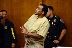 Charly Wingate arrives in court in Hackensack, NJ smiling and waving to his family Friday, Sept. 16, 2016.  The New York rap artist who was sentenced to 75 years in prison after a deadly robbery at a New Jersey hotel had his sentence cut by at least 55 years on Friday. Max B, whose real name is Charly Wingate, was re-sentenced by Bergen County Judge James Guida to 20 years after he pleaded guilty to aggravated manslaughter as part of a plea deal with prosecutors, attorney John Latoracca said.  (Tariq Zehawi/The Record of Bergen County via AP)