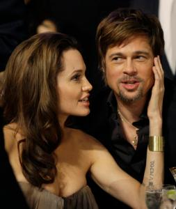 FILE - In this Jan. 27, 2008 file photo, Angelina Jolie, left, and Brad Pitt sit together before the start of the 14th Annual Screen Actors Guild Awards in Los Angeles. Angelina Jolie Pitt has filed for divorce from Brad Pitt, bringing an end to one of the world's most star-studded, tabloid-generating romances. An attorney for Jolie Pitt, Robert Offer, said Tuesday, Sept. 20, 2016, that she has filed for the dissolution of the marriage. (AP Photo/Kevork Djansezian, File)