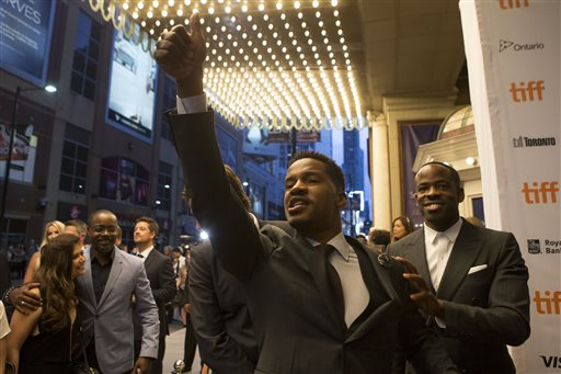 "Director and actor Nate Parker, center, gestures to the crowd as he arrives on the red carpet for the film ""Birth of a Nation"" during the 2016 Toronto International Film Festival in Toronto on Friday, Sept. 9, 2016. (Chris Young/The Canadian Press via AP)"