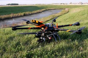 This Monday, Aug. 29, 2016, photo provided by Sharper Shape and SkySkopes shows a Sharper A6 drone before a test to fly over power lines in eastern North Dakota near Blanchard. The drone is specially designed for utility asset inspections. The drone is being tested as part of a project by Xcel Energy to see of unmanned aircraft can help crews restore power to areas hit by natural disasters. Officials with the company hope to be flying beyond visual line of sight by the end of the year. (/Sharper Shape and SkySkopes via AP)