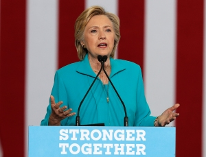 """FILE - In this Aug. 25, 2016 file photo, Democratic presidential nominee Hillary Clinton speaks in Reno, Nev. Following the public outcry over steep increases in price for an emergency allergy treatment, Clinton is pledging to better protect patients from such costs. Clinton is rolling out a plan Friday, Sept. 2, 2016, designed to give the federal government more power to push back against what she calls """"excessive unjustified costs"""" for medications that have long been on the market. (AP Photo/Carolyn Kaster, File)"""