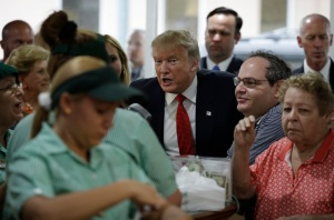 Republican presidential candidate Donald Trump visits a restaurant, Tuesday, Sept. 27, 2016, in Miami. (AP Photo/John Locher)
