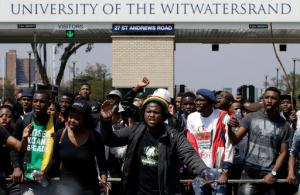 University students protest for free education at the entrance of the University of the Witwatersrand in Johannesburg, South Africa, Tuesday, Sept. 20, 2016. South African university students who want free education are protesting on several campuses, and police have arrested at least 10 students who blocked an entrance at the University of the Witwatersrand in Johannesburg. (AP Photo/Themba Hadebe)