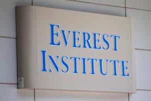 FILE - In this July 8, 2014 file photo, an Everest Institute sign is seen in a office building in Silver Spring, Md. The Education Department withdrew recognition of the nation's largest accreditor of for-profit colleges on Sept. 22, 2016, a decision that could force schools to close and threaten financial aid to hundreds of thousands of students. The Accrediting Council for Independent Colleges and Schools has 10 calendar days to notify the department if it will appeal the decision to Education Secretary John B. King Jr. The accrediting agency has been accused of lax oversight of its schools, which included those once owned by the now-defunct Corinthian Colleges Inc. and the recently shuttered ITT Technical Institute. (AP Photo/Jose Luis Magana, File)