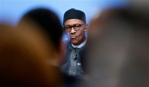 FILE- In this Thursday, May 12, 2016 file photo, Nigeria President Muhammadu Buhari listens during a panel discussion at the Anti-Corruption Summit in London, England. Nigeria's military says some officers are selling arms and ammunition to Boko Haram, indicating the corruption bedeviling the country's fight against the Islamic extremists continues despite government efforts to halt graft. The admission comes three weeks after the Nigerian army said a military tribunal is trying 16 officers and troops accused of offenses related to the fight against Boko Haram, including the theft and sale of ammunition. (AP Photo/Frank Augstein, Pool, File)