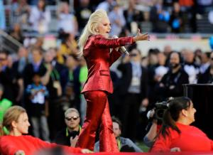 FILE - In this Feb. 7, 2016 file photo, Lady Gaga sings the national anthem before the NFL Super Bowl 50 football game between the Denver Broncos and the Carolina Panthers in Santa Clara, Calif. Lady Gaga will headline the Super Bowl halftime show next year. NFL and Pepsi announced Thursday, Sept. 29, 2016, that the pop star will take the stage on Feb. 5, 2017, at the NRG Stadium in Houston. (AP Photo/Julio Cortez, File)