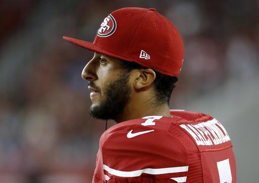 NFL's Kaepernick kneels during national anthem, continuing protest
