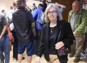 Former state epidemiologist Corinne Miller leaves court room after taking a plea agreement, at the 67th District Court in Flint, Michigan on Wednesday, Sept. 14, 2016. Former state epidemiologist Miller pleaded Wednesday to the misdemeanor neglect of duty charge in an investigation into Flint's lead-contaminated water crisis. The deal with prosecutors drops felony misconduct and conspiracy charges.   (Daniel Mears/The Detroit News via AP)