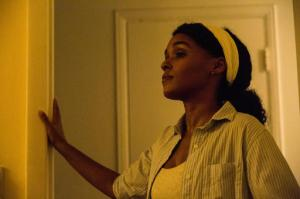 "This image released by A24 Films shows Janelle Monae in a scene from the film, ""Moonlight.""  The film is  a poetic coming-of-age tale told across three chapters about a young gay black kid growing up in a poor, drug-ridden neighborhood of Miami. (David Bornfriend/A24 via AP)"