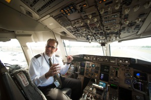 UPS Capt. Christian Kast talks about the Data Communications Data Comm technology from the cockpit of an UPS Boeing 767-300F aircraft at Dulles International Airport Air Traffic Control Tower in Sterling, Va., Tuesday, Sept. 27, 2016. Data Comm gives air traffic controllers and pilots the ability to transmit flight plans, clearances, instructions, advisories, flight crew requests, and reports via a digital message service. (AP Photo/Cliff Owen)