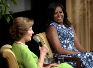 "First lady Michelle Obama listens as former first lady Laura Bush speaks during the ""America's First Ladies: In Service to Our Nation"" conference at the National Archives in Washington, Friday, Sept. 16, 2016. (AP Photo/Susan Walsh)"