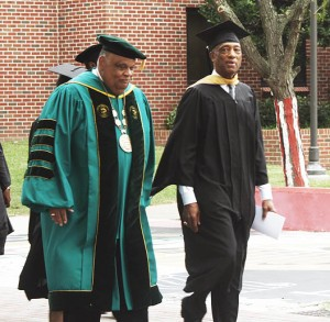 Newly invested President and CEO Eddie N. Moore, Jr. of Norfolk State University participates in a ceremonial walk from the Wilder Center to the Communications Tower while speaking with long-time Athletic Director Marty L. Miller (right) on Friday, Sept. 16, 2016. (Photo by Malik Glaspie, Spartan Echo managing editor)