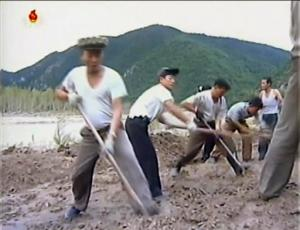 In this undated image from video distributed on Monday, Sept. 12, 2016, by North Korean broadcaster KRT, North Korean workers build levees along a river bank. North Korea is mobilizing to deal with a disastrous flood that killed more than 130 people, destroyed tens of thousands of homes and crippled infrastructure in its northern-most province. (KRT via AP)