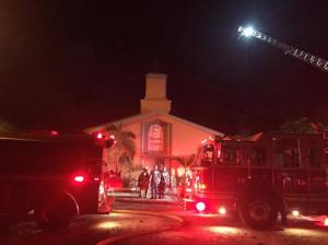 In this photo provided by the St. Lucie Sheriff's Office, firefighters work at the scene of a fire at the Islamic Center of Fort Pierce on Monday, Sept. 12, 2016, in Fort Pierce, Fla. (St. Lucie Sheriff's Office via AP)