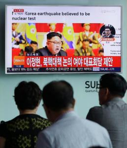 """People watch a TV news program showing North Korean leader Kim Jong Un at the Seoul Railway Station in Seoul, South Korea, Friday, Sept. 9, 2016. North Korea said Friday it conducted a """"higher level"""" nuclear warhead test explosion, which it trumpeted as finally allowing it to build """"at will"""" an array of stronger, smaller and lighter nuclear weapons. It is Pyongyang's fifth atomic test and the second in eight months. The letters read """" South Korean parties hold emergency meetings on North Korea's nuke test."""" (AP Photo/Ahn Young-joon)"""