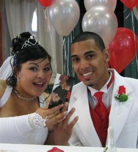 This undated photo provided by the U.S. Marshals shows Jihad Amir Ramadan, who is charged with murder, as he poses with an unknown woman at what Marshals believe is their wedding. Agents want to speak to the woman, although she's not suspected of any wrongdoing. Ramadan, who was born Justin Faustin, is accused of stabbing a fellow student at Hampton University in Virginia in 2005 and has been on the run ever since. (U.S. Marshals via AP)