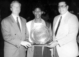Saunders, middle, is presented with the 1990-91 Honda Award as the Division II Female Athlete of the Year