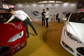 Norwegian Tesla owners sue car maker in horsepowerdispute